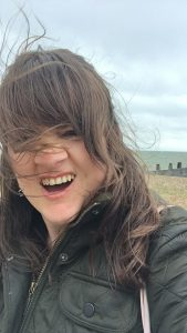 Windswept selfie of a woman on beach