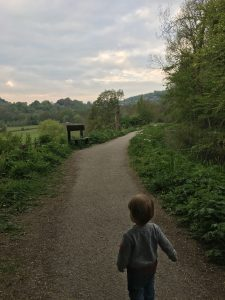 Toddler walking a canal path